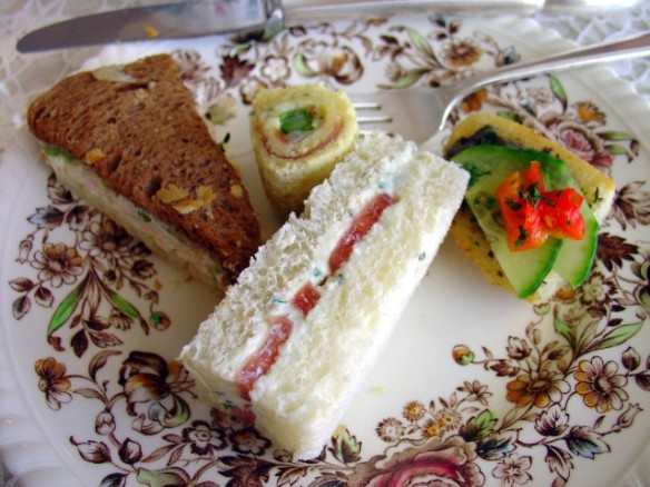 Left to right: Tomato cream cheese, cucumber with black olive tapenade on crostini, ham/asparagus pinwheel sandwich, and shrimp cocktail salad on rye/white
