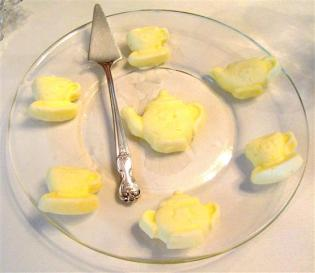 Teapot and teacup shaped butter pats