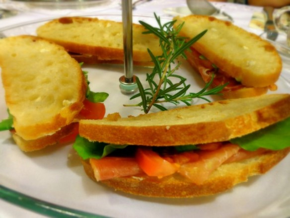 Italian club sandwiches with Proscuitto, cheese, and tomato, by Lady A.
