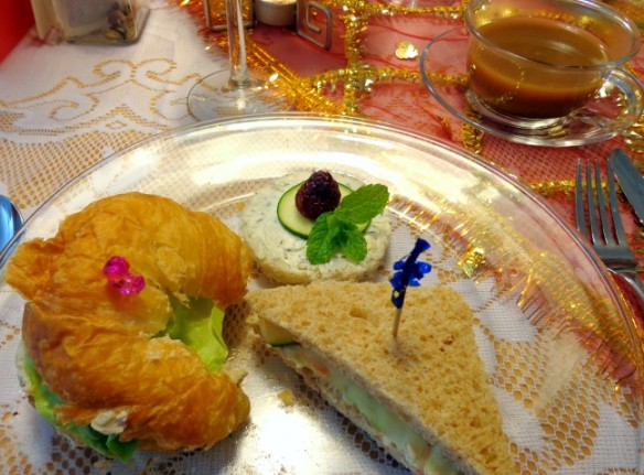 Lady T.'s curried chicken salad croissant, Lady B.'s mint chutney and cucumber, and carrot and cucumber sandwiches