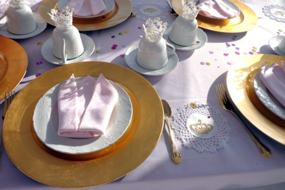 Crown fold napkins, lace crowns on bottom of teacups. and embroidered crowns on lace coasters (stiched by Queen B. herself!)