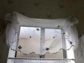 Window valance attached with teacups (photo by Lady B.)